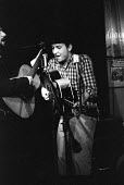 Bob Dylan playing a gig with Dave Van Ronk, New York, 1961. They were playing in a club in Greenwich Village, New York, USA, 1961 before Dylan's first album. - NLA - 23-04-1961