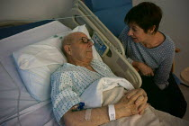 22-11-2015 - Elderly patient discussing treatment with a reluctant relative, The Princess Royal Hospital, Telford © John Harris
