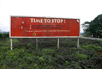 10-11-1999 - A sign erected by the Nigerian government to try and stop sabotage and people from tampering with oil pipelines in the Delta region of Nigeria. © Adrian Arbib