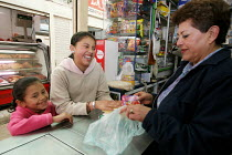 15-11-2006 - Children buy some food in a shop in Bogota, November 2006. © Boris Heger