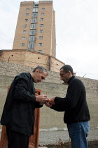 28-02-2005 - Two detainees who have tuberculosis light a candel before praying for their health, at the central prisons hospital, Yerevan, Armenia, February 2005. Tuberculosis is a disease that is widespread in ja... © Boris Heger
