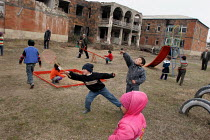03-03-2005 - Children play in front of their former school destroyed during the war, Khramort, Nagorno Karabakh, Azerbaidjan, March 2005. The region, although officially located within Azerbaidjan, is being occupi... © Boris Heger