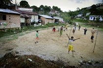 11-03-2012 - Children play football on a pitch located next to illegal gold mines. The Colombian government says it wants to control illegal mining and is giving licenses to big multinationals. Colombia is poised... © Boris Heger