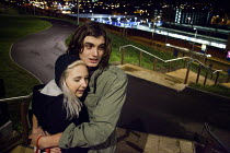 23-12-2011 - Hugging to keep warm while waiting for a taxi by Park Hill estate Sheffield, ready to have a nightout on the town. © Connor Matheson