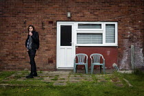 04-06-2012 - Jordan smoking in the back garden of his house where he lives with his father in Darfield Barnsley. Now with the introduction of the spare bedroom tax, Jordan's bedroom is deemed spare because he is g... © Connor Matheson