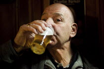 07-04-2012 - An ex miner drinking a half pint of real ale at his local club in Wakefield. Jeff says he loves real ale