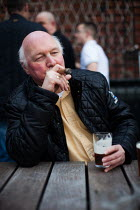 05-04-2014 - A man celebrates the weekend with a cigar in a Sheffield pub. © Connor Matheson
