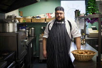 16-12-2014 - The head chef who trains local people how to cook, the people training with him have the possibility of getting a qualification at the end of their training. All food made in the Community shop cafe i... © Connor Matheson