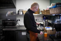 16-12-2014 - A young man on the 10 month chef training scheme. The Community Shop, Goldthorpe, South Yorkshire. © Connor Matheson