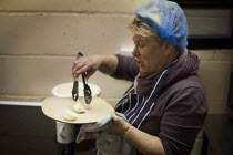 02-02-2015 - Breakfast being prepared. The Drop in Kitchen, Barnsley Centre. © Connor Matheson