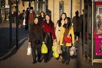 14-03-2015 - Asian women carrying their shopping. Sheffield, South Yorkshire. © Connor Matheson