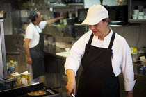 21-04-2015 - Chefs preparing food, Tropicana Hotel kitchen. Tourism is a vital industry for the maltese economy, contributing 15 to its GDP. Since 2009 Malta has experienced a 10 drop in tourism. Tropicana Hotel.... © Connor Matheson
