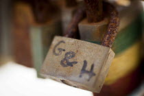 23-04-2015 - Love locks locked onto a railing at The Point, overlooking the sea and Valletta. Love locking is a trend of locking padlocks to a bridge or railing in order to symboloise love. The trend has been cotr... © Connor Matheson