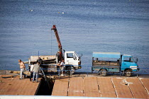 23-04-2015 - Workers maintaing flood defences. Bugibba, Malta. © Connor Matheson