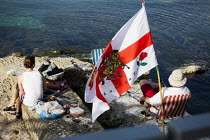 23-04-2015 - English tourists abroad, having a beer and a BBQ by the sea with a flag. Tourism is a vital industry for the maltese economy, contributing 15 to its GDP. Since 2009 Malta has experienced a 10 drop in... © Connor Matheson