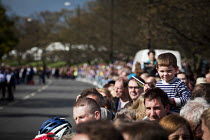 03-05-2015 - Local people and cycling enthusiasts watching the first anual Tour De Yorkshire, a cycling race inspired by the success of the Tour De France. Roundhay Park, Leeds, West Yorkshire © Connor Matheson