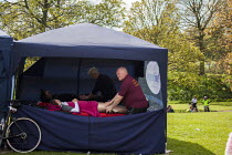 03-05-2015 - A massage warm down tent for those who have cycled to the Tour De Yorkshire finish line. Roundhay Park, Leeds, West Yorkshire © Connor Matheson