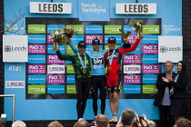 03-05-2015 - Norwegian Lars Nordhauge from team Sky on the podium after being announced the first winner of the Tour De Yorkshire. He is joined by BMC's Ben Herman. Roundhay Park, Leeds, West Yorkshire © Connor Matheson
