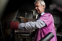 18-05-2015 - A worker cooling hot steel. J Adams and Sons manufacture a range of military and cooking knives out of steel using traditional hand based production methods. The family business employs around 16 peop... © Connor Matheson