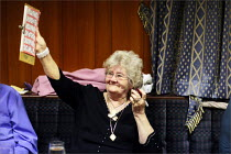 15-05-2009 - A woman claims a win on the bingo at the Cleveleys Working Men's Club, Lancashire. © Christopher Thomond