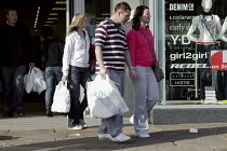 14-03-2009 - Young couple carrying their shopping bag of new clothes,town centre of Chesterfield, Derbyshire © David Mansell
