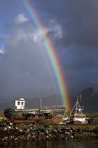 05-10-2012 - Derelict fishing boats, Derryinver Pier, Letterfrack, Connemara, County Galway. And rainbow. EU Common Fisheries Policy has led to the contraction of the Irish fishing industry © David Mansell