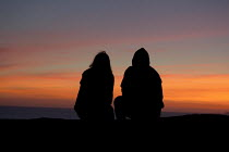 05-09-2012 - A young couple on holiday watching the sunset, Freshwater West, Pembrokeshire © David Mansell
