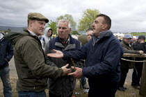 06-06-2015 - Appleby Horse Fair, Cumbria, horse dealing by well known Appleby characters, middle is John Skyes 84, on the right is Chris Booth from Nottingham, doing a deal with a technique known as the slap of th... © David Mansell