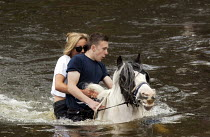 07-06-2015 - Appleby Horse Fair, Cumbria, washing horses in the River Eden. Young people often first meet their future marriage partners at Appleby Fair. Riding together are Arran Boot and Jasmine May, both 17 yea... © David Mansell