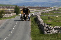 08-06-2015 - Appleby Horse Fair, Cumbria, Horse drawn caravan returning home along the scenic open moorland route from Kirkby Stephen to Sedbergh. Terry Carney and his son Albert from Blackpool, are using this fav... © David Mansell