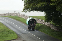 08-06-2015 - Appleby Horse Fair, Cumbria, horse drawn caravan returning home from the Fair using the spectacular scenic open moorland route from Kirkby Stephen to Sedbergh. © David Mansell