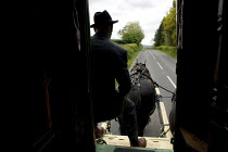 09-06-2015 - Appleby Horse Fair, Cumbria, Farmer Frank Throup in a horse drawn caravan returning home using the spectacular scenic open moorland route from Kirkby Stephen to Sedbergh. © David Mansell