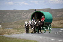 10-06-2015 - Appleby Horse Fair, Cumbria, Appleby Horse Fair, Cumbria, Brian Metcalfe who has a long family history of owning and breeding horses in his horse drawn caravan returning along the Hartside Pass © David Mansell