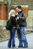 15-03-2005 - Birmingham University - student undergraduates on campus. A young couple obviously in love seen holding each other. © David Mansell