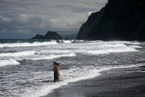 13-02-2010 - Lovers watch the surf at the beach in the remote Pololu Valley. The Hamakua coast on the windward side of the big island of Hawaii, Pacific Ocean. © David Bacon