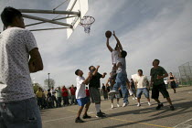 20-03-2010 - Madera, USA, Immigrants from Oaxaca play basketball in a tournament organized every year by the Binational Front of Indigenous Organizations. Other communities in the San Joaquin Valley also form team... © David Bacon