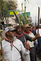02-10-2014 - MEXICO CITY, MEXICO Farmers from Atenco, outside Mexico City holding up corn and machetes to protest at their eviction from their land to make way for a new airport development. Students and workers m... © David Bacon