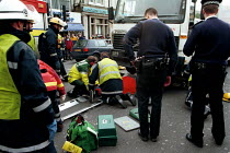 12-10-2000 - Emergency Services rescuing a pedestrian trapped under a lorry. London © Duncan Phillips