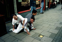 22-07-2000 - Shop Assistants apprehend a suspected shoplifter. Islington London © Duncan Phillips