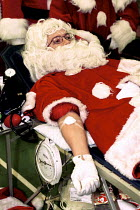 15-12-1999 - Santa giving Blood as part of a campaign to prevent a shortage over the christmas holiday. © Duncan Phillips