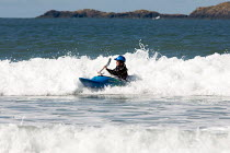 11-04-2009 - Young woman surfing in canoe Pembrokeshire, Wales © Duncan Phillips