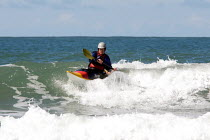 11-04-2009 - Elderly silver surfer surfing in canoe, Whitesands , Pembrokeshire, Wales © Duncan Phillips