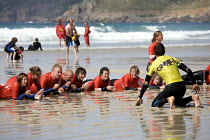 18-08-2010 - Surfing instructor with beginners, Surf School, Sennen Cove, Cornwall © Duncan Phillips