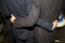 19-07-2012 - Two men in Business Suits arm in arm, wine bar City of London © Duncan Phillips