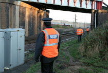 17-12-1999 - BR Police & Railway workers on anti vandalism patrol. This type of vandalism increases during school holiday periods so a dedicated team patrol the tracks to prevent and clear up any danger. © Duncan Phillips