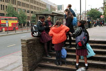 18-10-1999 - Secondary school children waiting for a bus after school. London © Duncan Phillips