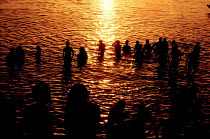 01-12-1997 - Bathers taking evening bath in the Ganges, Varanassi, India © Duncan Phillips
