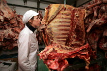 20-01-2005 - Environmental Health officer inspecting meat at a Butchers shop, Queens Market, Newham. © Duncan Phillips