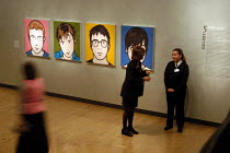 22-10-2003 - Attendants at the Hayward Gallery stand next to the work of the artist Julian Opie. His portraits of Blur form part of the exhibition 'Saved' - 100 Years of the National Art Collections Fund exhibitio... © Geoff Crawford