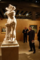 22-10-2003 - A spectator views The Three Graces at The Hayward Gallery. On the wall behind is Weeping Woman by Pablo Picasso. The works form part of the exhibition 'Saved' - 100 Years of the National Art Collectio... © Geoff Crawford